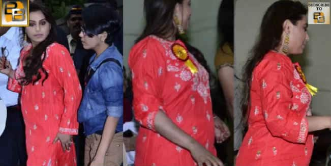 Is Rani Mukerji trying to hide her baby bump? Watch video