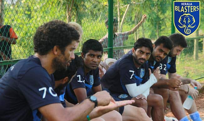 David James (left) in discussion with his teammates.
