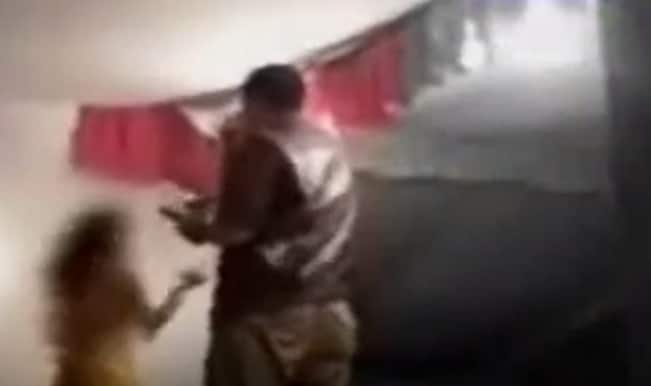 Shameful video! Drunk UP cop forces female dancer to perform at gunpoint