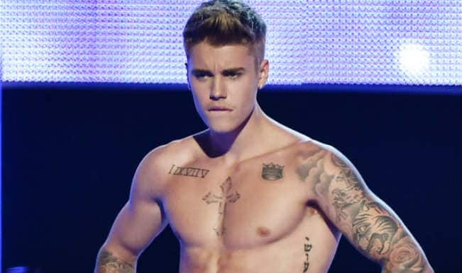 Justin Bieber flaunt real abs post photoshopped images