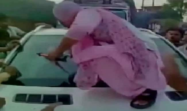 Woman smashes Mercedes of Samajwadi Party leader Abhinav Sharma after his gunman winks at her