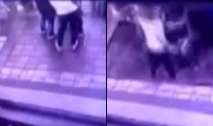 Watch sinkhole swallow commuters near a bus stop in China