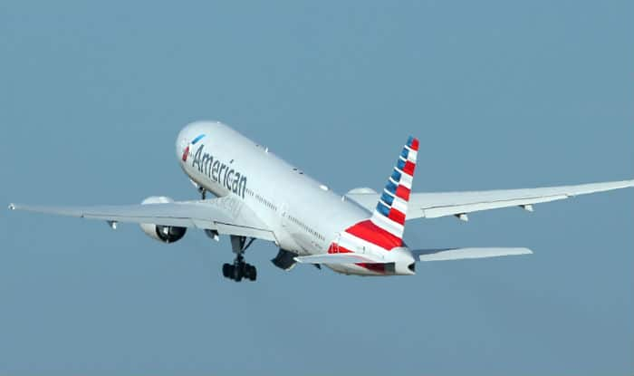 American Airlines attendant throws woman passenger out of flight!