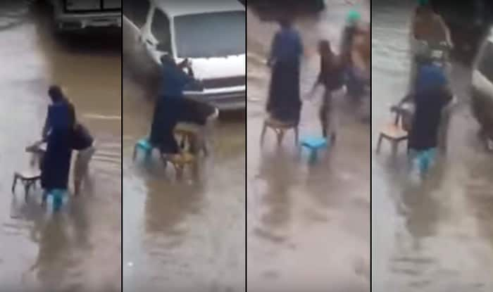 Husband helping wife cross road in Chennai flood will leave you speechless!
