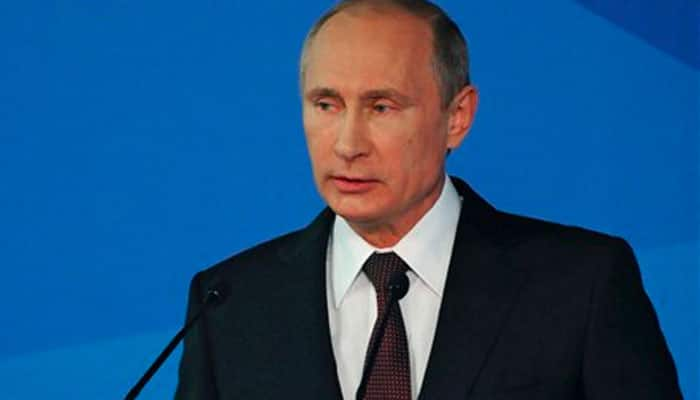 Vladimir Putin fires economy minister over bribe charges