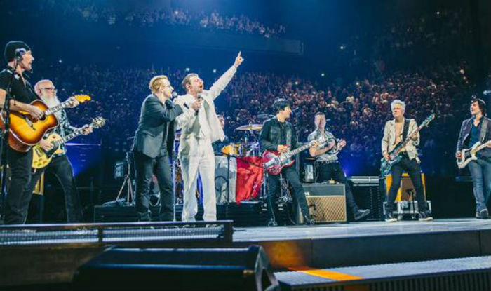 Eagles of Death Metal members appear with U2 on Paris stage