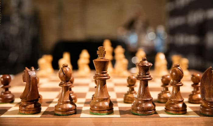 Representative image of a chess board and pieces.