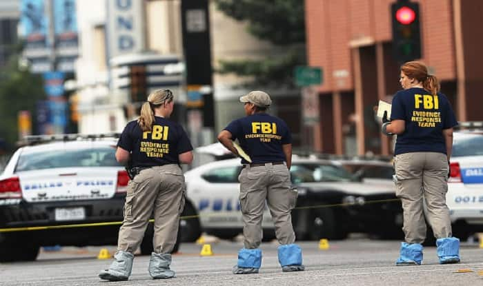 Police: Dump truck driver says he has bomb, smashes FBI gate