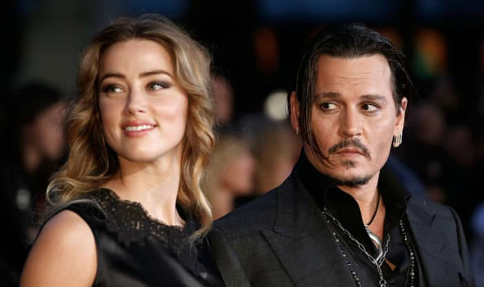 Amber Heard withdraws restraining order against Johnny Depp