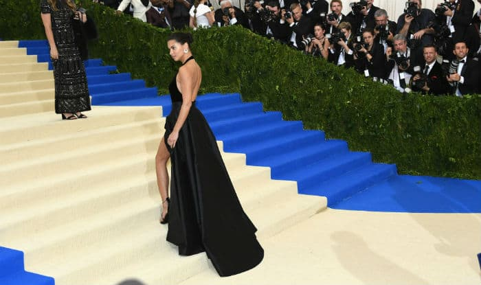 42d236a15e05 Adriana Lima's wardrobe malfunction at Met Gala 2017: Victoria's Secret  model flashes underwear in a black slit gown