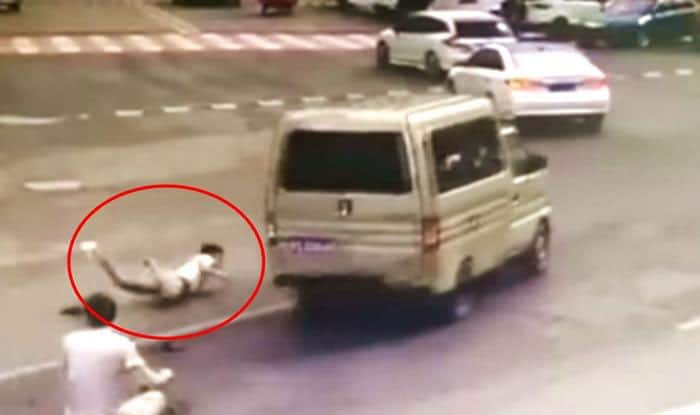 CCTV footage shows man jumping out of moving van in China moments before it catches fire