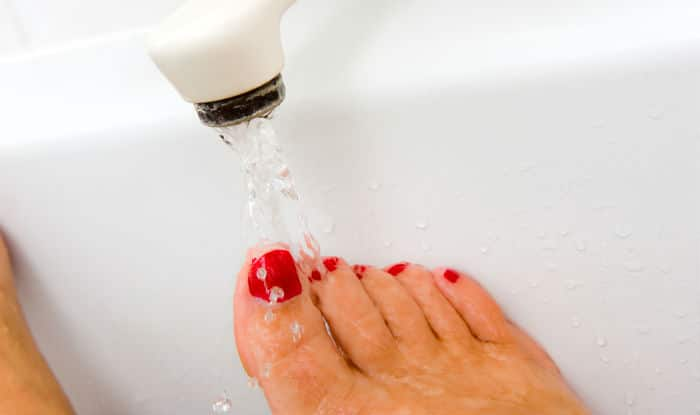 Scrub your feet with soap