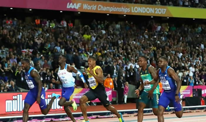 Athletes in action at Men's 100 metres event. (Getty Image)