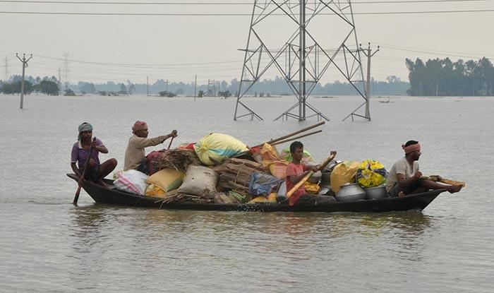 People evacuate along with their belongings in West Bengal