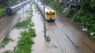 Mumbai Rains in Photos: Waterlogging at Many Places; Local Trains Stalled