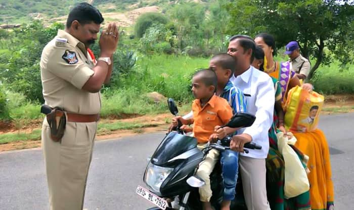 Photo Of Andhra Pradesh Police Officer Folding His Hands In Front Of An Overloaded Biker Family Is Viral