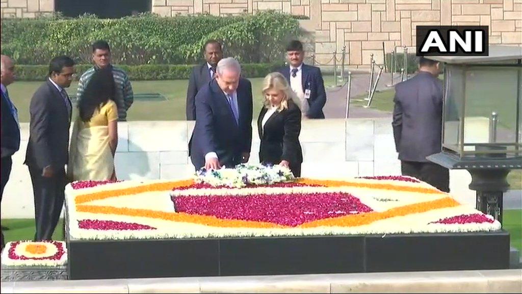 Israel PM Benjamin Netanyahu, wife Sara at Raj Ghat. (Photo/ANI)