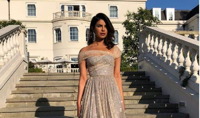 Priyanka Chopra Looks Like A  Princess In A Shimmery Dior Number At Prince Harry And Meghan Markle's Royal Wedding Reception