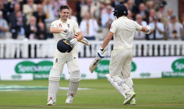 Chris Woakes celebrates reaching his century with teammate Jonathan Bairstow during day three of the 2nd Test between England and India at Lord's_Getty