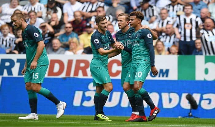Dele Alli celebrates with teammates Harry Kane and Ben Davies after scoring his team's second goal during the Premier League match between Newcastle United and Tottenham Hotspurs_Getty