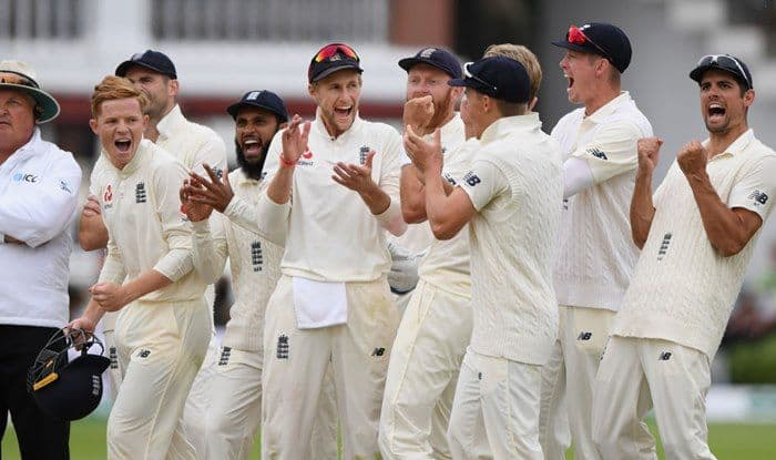 Joe Root and teammates celebrate after the review of Virat Kohli wicket against India at Lord's_Getty