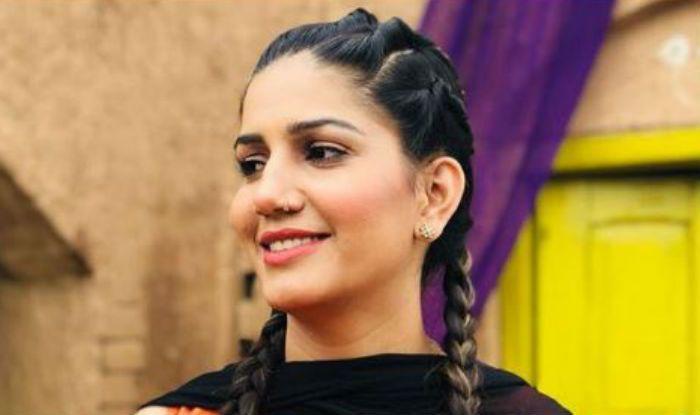 Haryanvi Dancer Sapna Choudhary Looks Sexy Yet Elegant in Black And Orange Ensemble – View Hot Picture