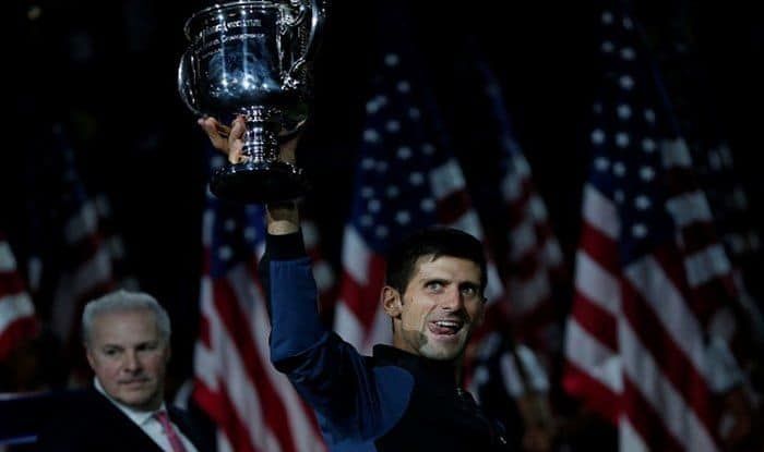 Novak Djokovic holds the championship trophy after winning his men's singles finals match against Juan Martin Del Potro at US Open 2018_Getty