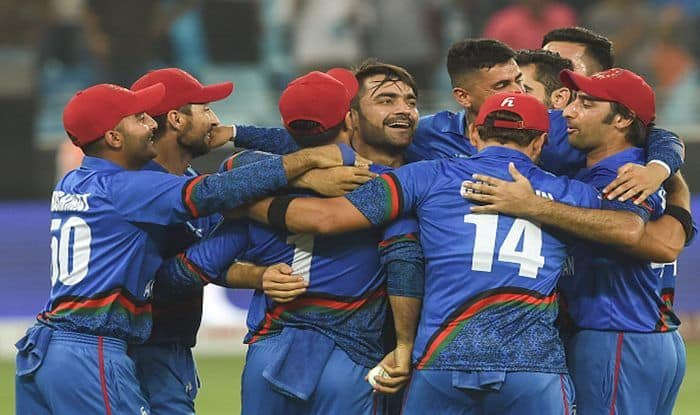 Rashid Khan (C), captain Asghar Afghan (R) celebrates with teammates after playing a tie against India in Asia Cup_Getty