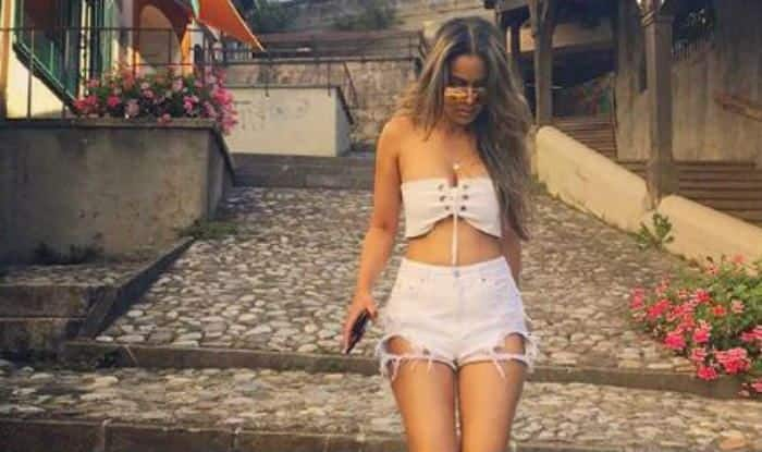 Second Sexiest Asian Woman Nia Sharma Looks Super Hot in White Tube Crop Top and Ripped Shorts – See Pictures