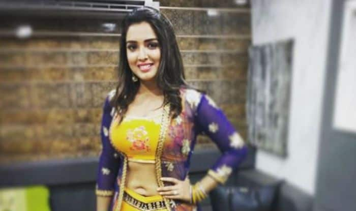 Bhojpuri Hottie Amrapali Dubey Looks Sexy as She Flaunts Her Washboard Abs in Yellow Lehenga – See Picture