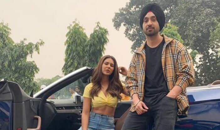 Pollywood Hit Jodi Sonam Bajwa And Diljit Dosanjh Up The Hotness Quotient as They Strike a Pose in Luxury Car – See Pictures