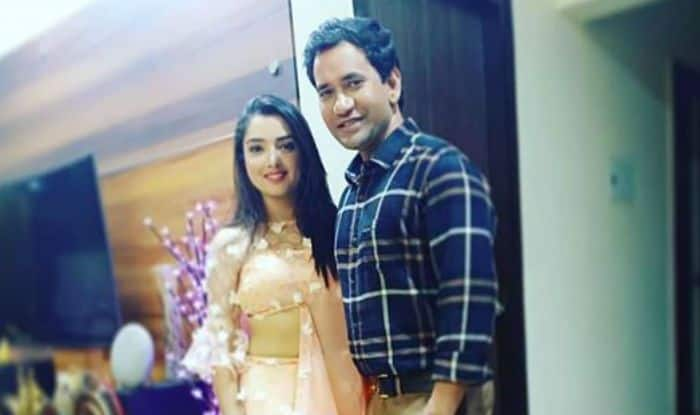Bhojpuri Bomb Amrapali Dubey Looks Hot in Sexy Peach Lehenga While Posing With Dinesh Lal Yadav Aka Nirahua