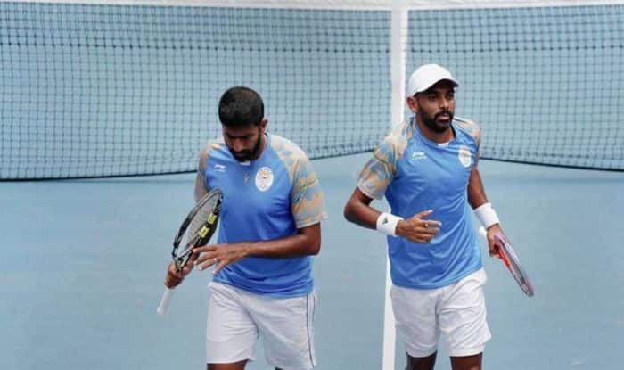 Rohan Bopanna and Divij Sharan in action in Men's Doubles in Asian Games 2018_PTI