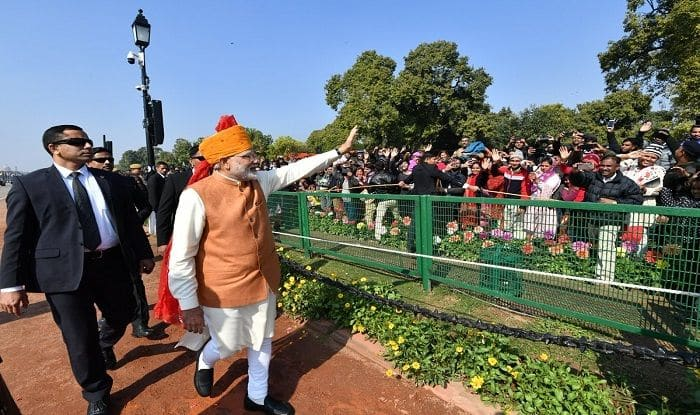 Prime Minister Narendra Modi greets crowd at Rajpath
