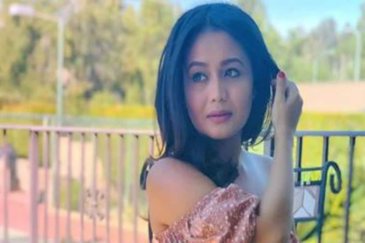 Singing Sensation Neha Kakkar Looks Sizzling Hot In Floral Peach Crop Top And Skirt In Her Latest Sun Kissed Pictures India Com