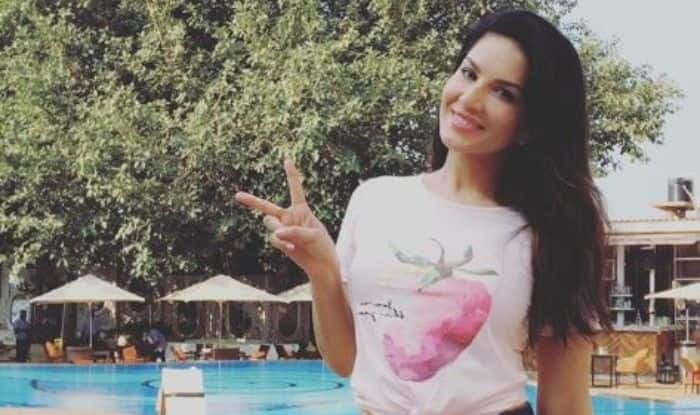 Sunny Leone Looks Sexy as She Poses in White Crop Top And Denim Shorts