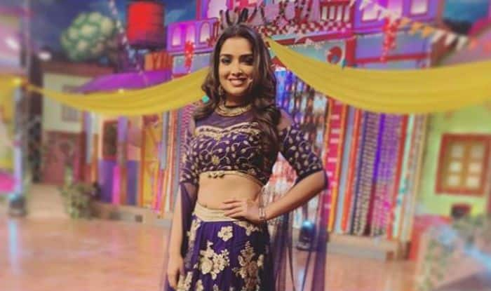Bhojpuri Actress Amrapali Dubey Looks Her Sexiest Best in Dark Purple And Golden Lehenga