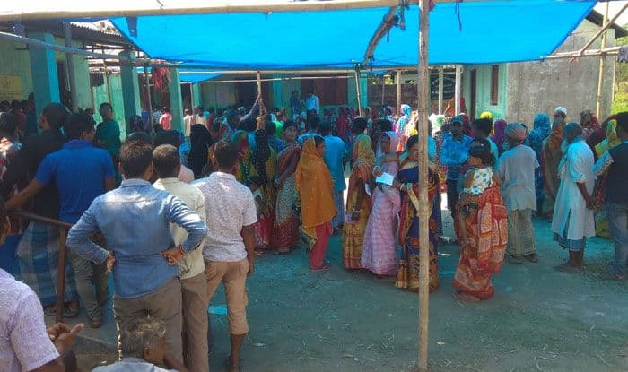 People waiting at polling station in Cooch Behar