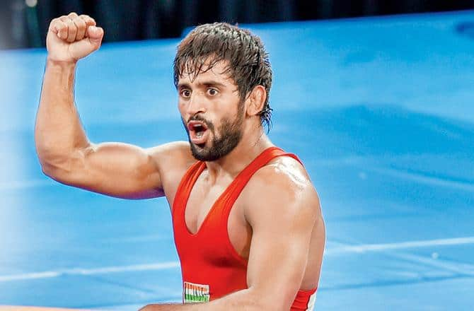 Bajrang Punia, World Wrestling Championships 2019, Bajrang Punia wins bronze in World Wrestling Championships, Bajrang Punia clinches bronze World Championships 2019, Bajrang Punia Records, Bajrang Punia bags third World Championship Medal, Bajrang Punia creates history, Wrestling Tournament, Wrestling News, Bajrang wins bronze in 65kg freestyle Wrestling, Bajrang Punia best wrestler, Bajrang Punia no.1 wrestler, Sports News, Bajrang Punia achievements