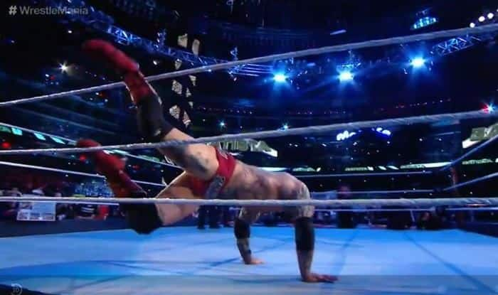 Batista Topples over the ropes