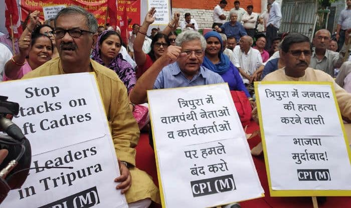 CPI-M workers stage a sit-in demonstration, demanding repoll