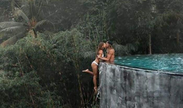 Man Clicks Picture With Girlfriend Hanging From The Edge of Infinity Pool