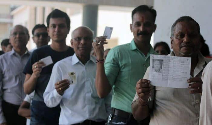 Men standing in queue to vote in Ghaziabad