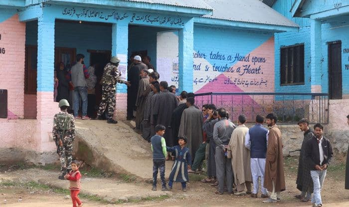 People at a polling booth in Kupwara