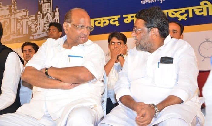 NCP leaders Sharad Pawar and Nawab Malik