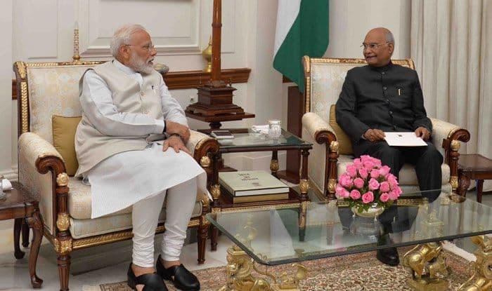 PM Narendra Modi with President Ram Nath Kovind. Photo Courtesy: IANS