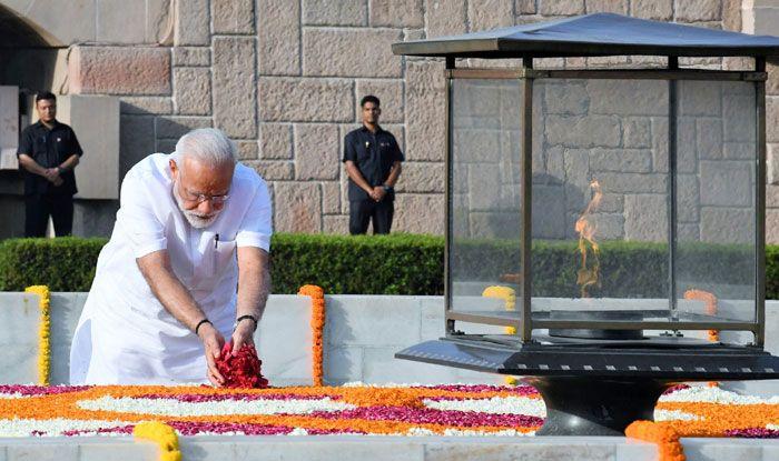 Narendra Modi pays homage to Mahatma Gandhi. Photo Courtesy: IANS