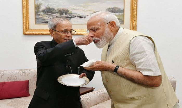Pranab Mukherjee Feeds Sweets to PM Modi, Wishes Him For His Vision of 'Sabka Saath, Sabka Vikas'