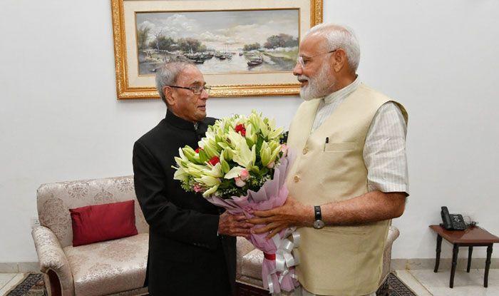 Former President Pranab Mukherjee with Narendra Modi. Photo Courtesy: IANS
