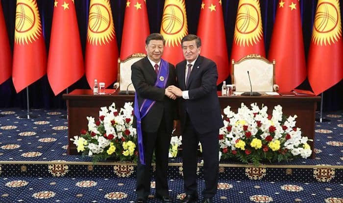 Chinese President Xi Jinping (L) with Kyrgyz President Sooronbay Jeenbekov. Photo Courtesy: Getty Images